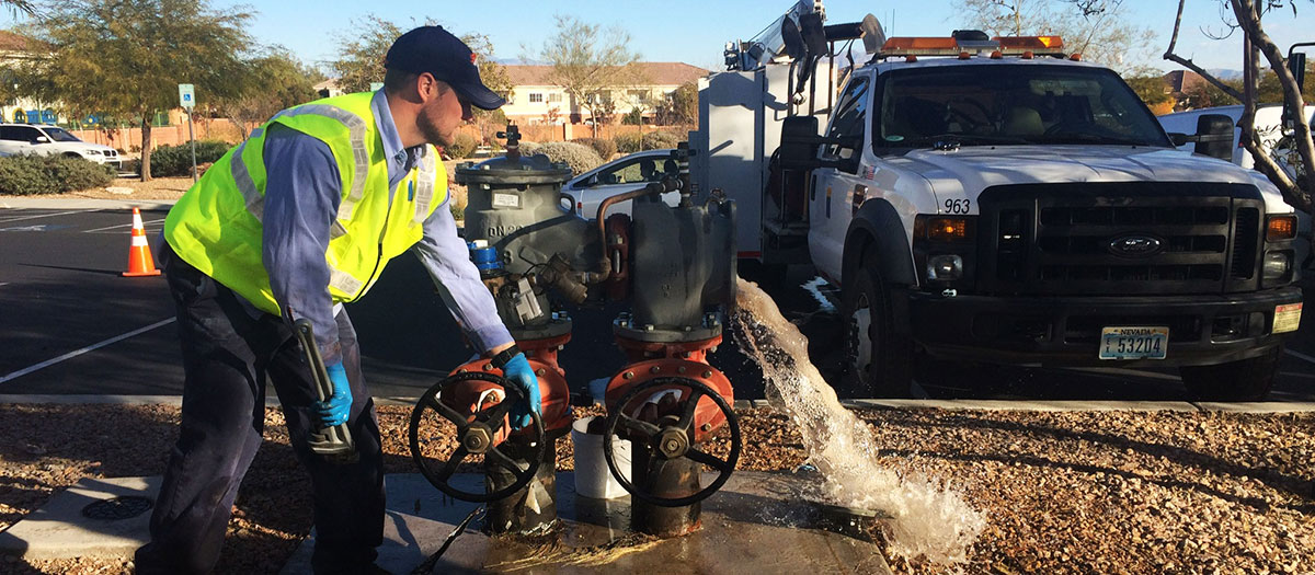 Las Vegas Valley Water District employee performing work on backflow prevention device.