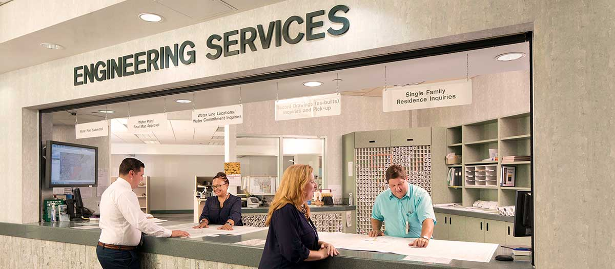 LVVWD employee assisting man at Engineering Services counter.